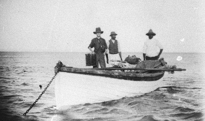 Image of men on a boat