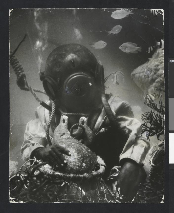 Staged photographed of an underwater scene with a hard-hat diver