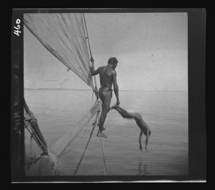 Men diving from a boat