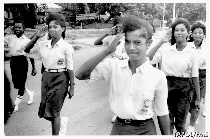 Students from Escola Female Secondary School parading in Dili in June 1990.