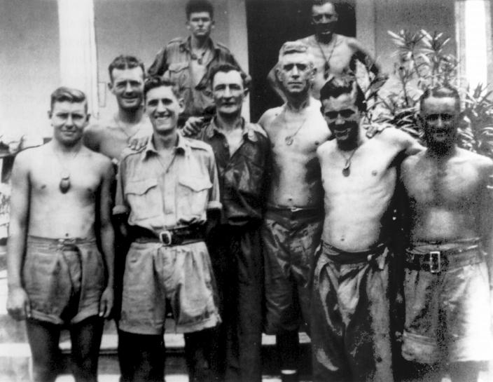Medical Officer Capt Roger Dunkley (front row third from right) with members of