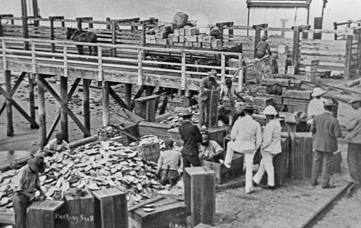 Packing shell at the end of Port Hedland jetty, c. 1910.