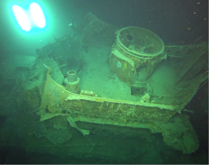 15-cm shell hole and the damage to HMAS Sydney's  Direction Control Tower  base.