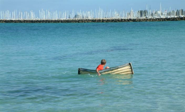 Exploring the Blue. 12-year-old Matthew Turner paddling this tin canoe, similar