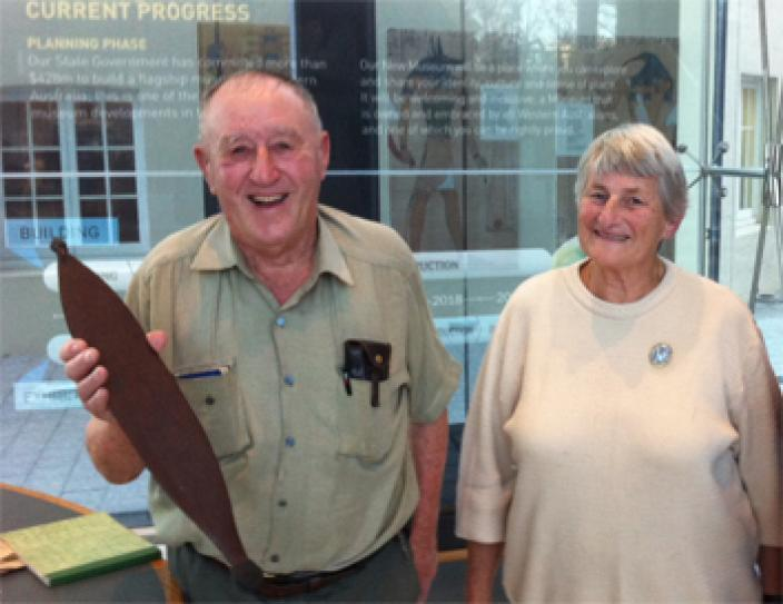 Dick and Rita Roberts holding one of the donated spearthrowers at the WA Museum.