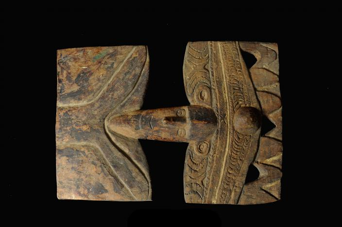 Hard wood plaque from the Middle Sepik region. Front View.