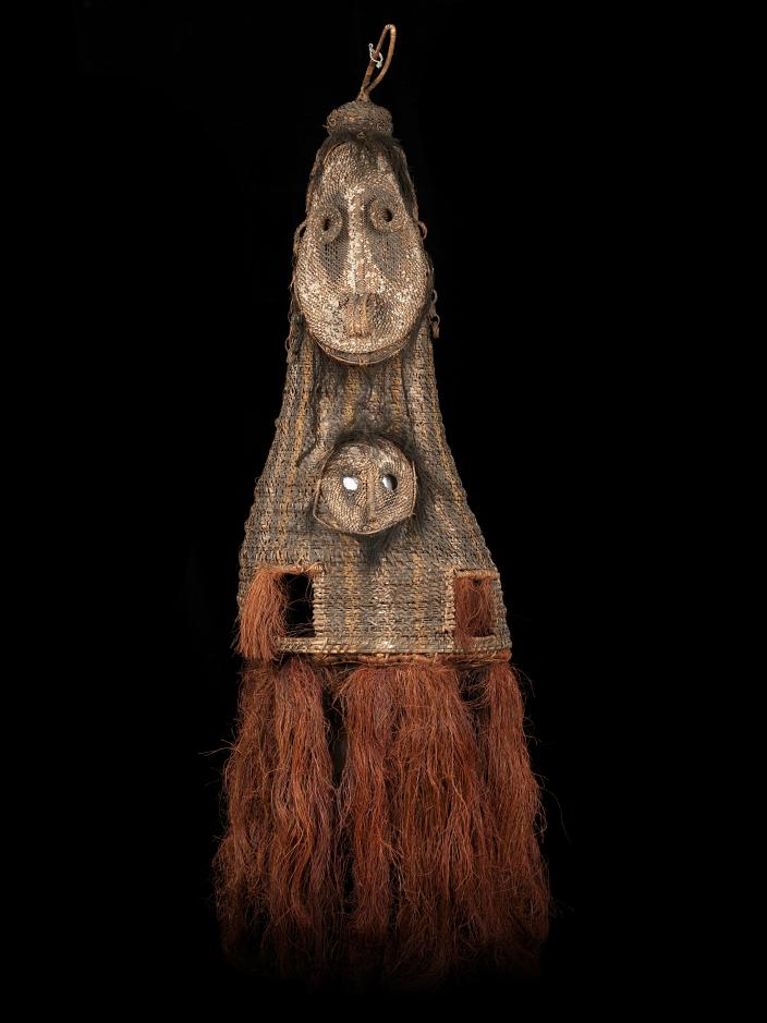 A double faced, tall woven dance mask from Kanganaman Village. The mask has two