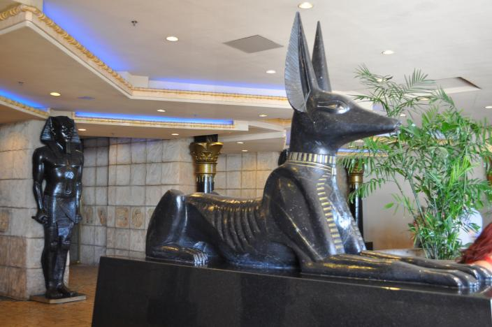 A statue of Anubis guarding the entrance to a Casino