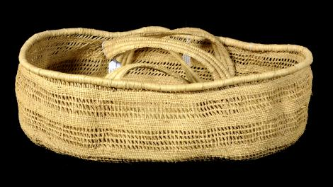 An open, oval, double handled, pandanus palm basket.