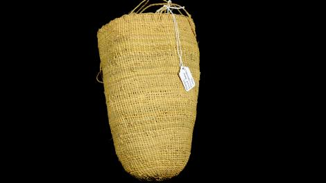 A small dilly bag with a string handle.