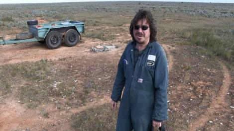 A man standing in the vast expense of the Nullarbor