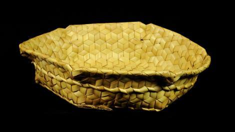 An open top basket with a hexagonal shape.