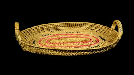 An oval tray with twining in a Samoan weave.
