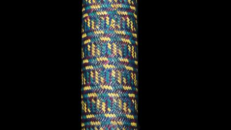 A long bamboo cylinder covered with plaited weaving in split bamboo.