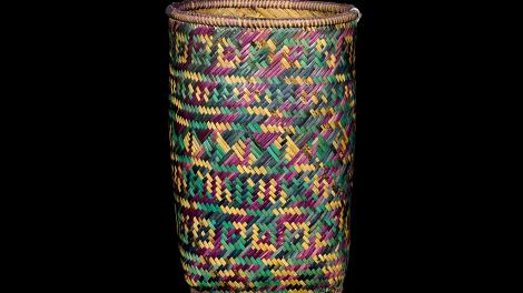An open top basket with plaited weaving in split bamboo.