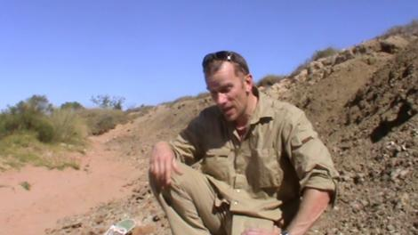 Mikael Siversson talking to camera in the Australian outback