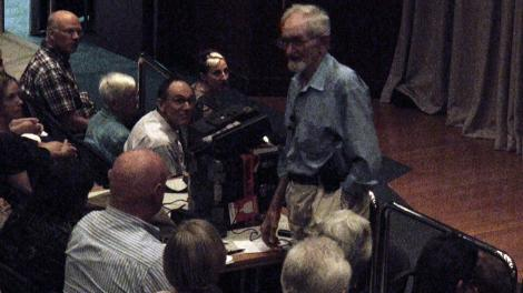 Harry Butler standing amongst the crowd of his In the Wild West Lecture