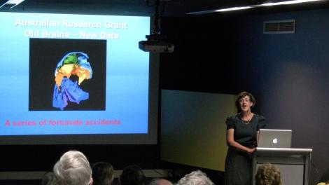 Dr Kate Trinajstic, lecturing in front of a crowd at the WA Museum