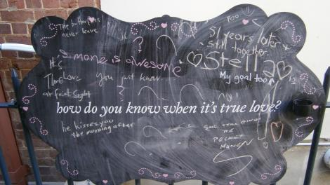 A chalk board with visitor reactions to the Unveiled exhibition