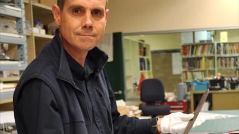 Western Australian Museum curator Stephen Anstey with the sabre used by Henry Dyson Naylor in 1854