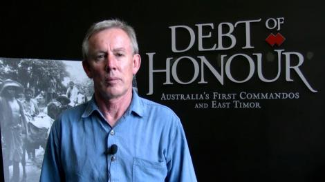 Paul Bridges standing in front of entry to the exhibition Debt of Honour