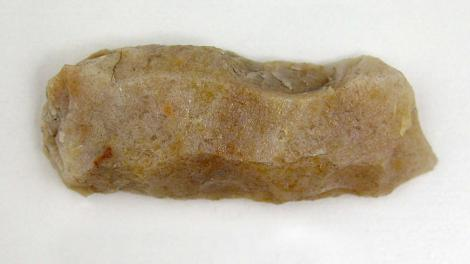 A stone artefact with resin