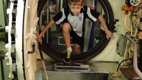 Boy coming through port hole at Maritime Museum