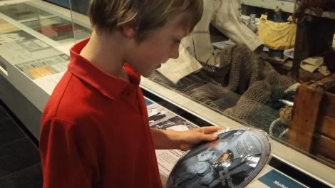 Boy looking at object in Maritime Museum