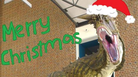 A Christmas hat and mistletoe masterfully painted on to the Museum's Carnosaurus