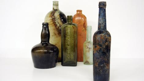 A series of coloured bottles