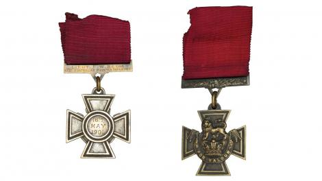 Front and back views of a Victoria's Cross medal