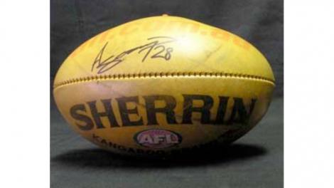 An AFL football, signed by Ashley Sampi