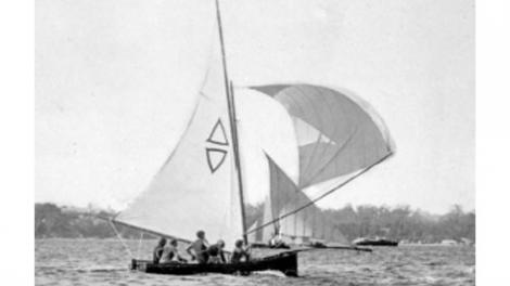 A black and white photo of a racing dinghy