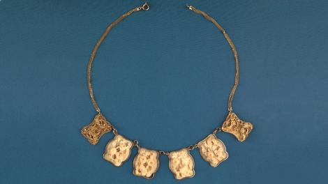 An ivory and gold necklace