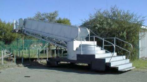 A passenger gangway, on the back of a truck
