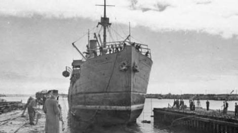 A large war ship entering the Fermantle slipways