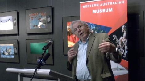 Sir David Attenborough standing at a podium