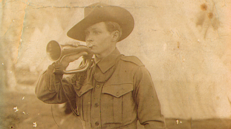 Roscoe playing his bugle at Blackboy Hill Camp. Dated 9-9-14