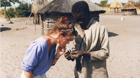 Karen Posing with locals' on Zambia's Barotse Plains, near the Angolan border.