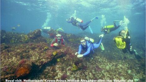 Several divers exploring a shipwreck site