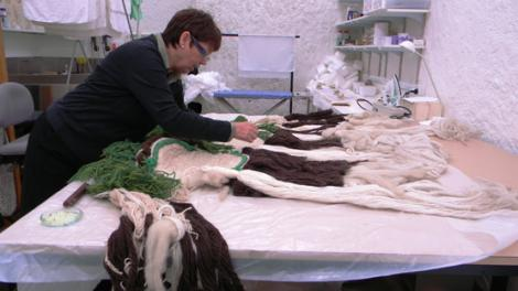 Museum staff member performing textiles conservation