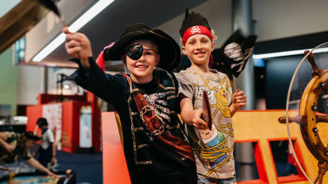 """""""Two young boys dressed as pirates."""""""