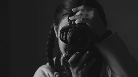 A girl holding a camera