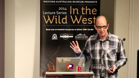 Paul Doughty giving a lecture at a lectern