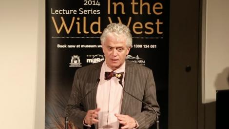 Dr Ian D. MacLeod standing at a lectern giving a presentation