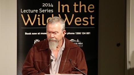 Mack McCarthy presenting at a lecturn