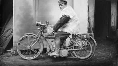 Corporal James Davie Renner, 4th Divisional Signals Company, of Fremantle, Western Australia sitting on a motorbike