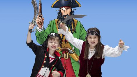 Children dressed up as pirates with one of the characters from Horrible Histories