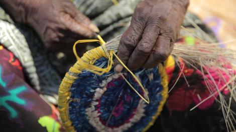 Tjawina Porter from Tjukurla (WA) 2014. Photo by Claire Freer © Tjanpi Desert Weavers NPY Women's Council
