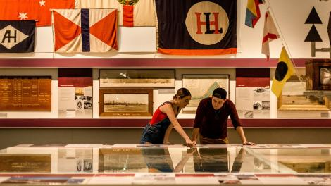 A young man and woman standing inside a WA Maritime Museum gallery